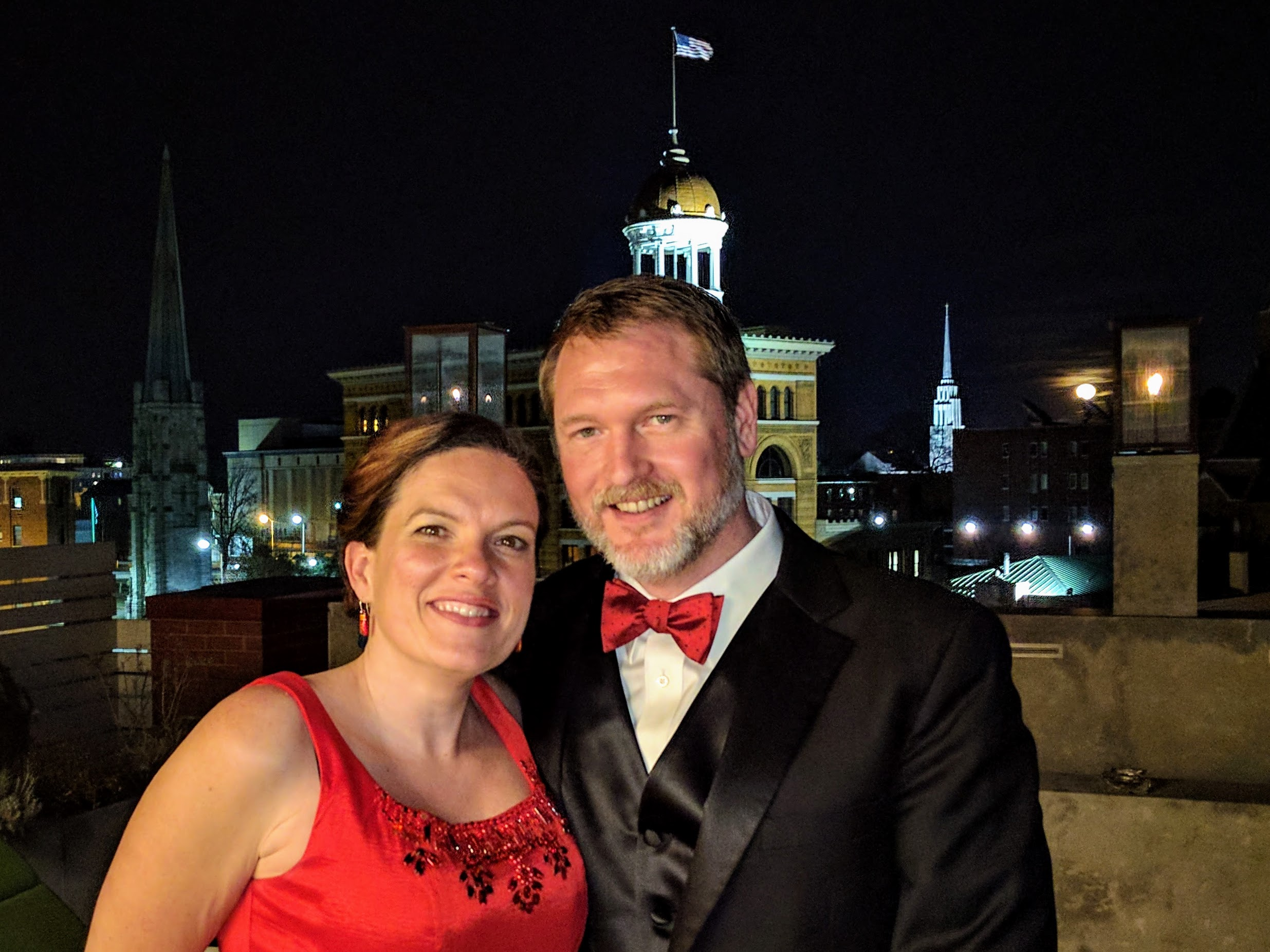 Geoffrey McGowen & wife Olivia pose with the Dome Building behind them.